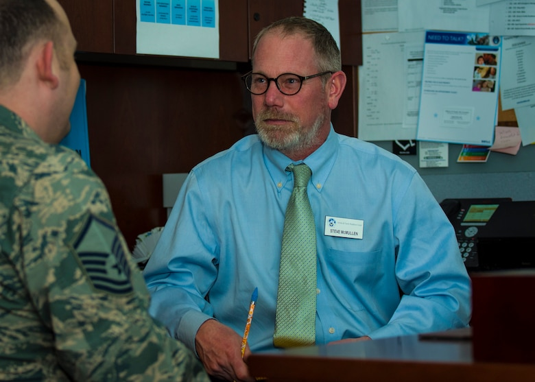 Steve McMullen, 92nd Force Support Squadron Airman & Family Readiness Center school liaison officer, speaks with an Airman at Fairchild Air Force Base, Washington, March 14, 2018. The counselors at the AFRC work to provide readily accessible resources to support Airmen and their families physically, mentally, spiritually and socially. (U.S. Air Force photo/Airman 1st Class Whitney Laine)