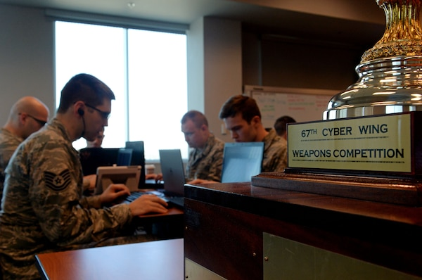 Cyberspace professionals from the 67th Cyberspace Wing compete in the annual weapons competition, March 7, 2018, in San Antonio, Texas. First, second and third place winners were named in individual, mixed team and unit categories. (U.S. Air Force photo by Tech. Sgt. R.J. Biermann)