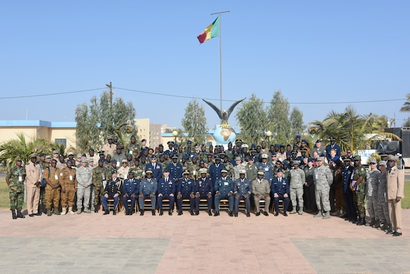 Participants of African Partnership Flight Senegal pose for a photo after the opening ceremony of APF at Captain Andalla Cissé Air Base, Senegal, March 19, 2018. Ten nations are participating in this event, which will focus on casualty evacuation, aeromedical evacuation, as well as air and ground safety. (U.S. Air Force photo by Airman 1st Class Eli Chevalier)