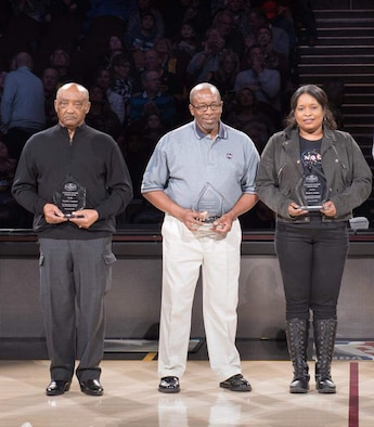 Dr. Woodrow Whitlow, Jr., center, technical director for the AEDC Test Operations and Sustainment contractor, receives recognition at the Cleveland Cavaliers half-time Feb. 25 as part of a Black Heritage Celebration honoring pioneers in space travel. Whitlow was the first African-American director of Research and Technology at NASA Glenn Research Center (GRC) in Cleveland, Ohio, and served in this role from September 1998 until September 2003. Also honored for their NASA contributions and leadership at GRC were Donald Campbell (left) and Robyn Gordon (right). (Courtesy photos)