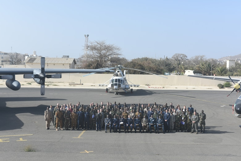 Participants of African Partnership Flight Senegal pose for a photo after the opening ceremony of the week-long aviation engagement at Captain Andalla Cissé Air Base, Senegal, March 19, 2018. Ten nations are participating in this event, which will focus on casualty evacuation, aeromedical evacuation, as well as air and ground safety. (U.S. Air Force photo by Airman 1st Class Eli Chevalier)