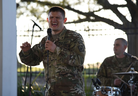 U.S. Army Sergeant Brandon Tingstrom, U.S. Army 41st Army Band vocalist and musical ambassador, Mississippi Air National Guard, Jackson, Mississippi, performs at the Biloxi Lighthouse Park Pavilion March 13, 2018, in Biloxi, Mississippi. The band has been providing musical support and entertainment for over 50 years. They also performed at the White House Hotel, in Biloxi, Mississippi, and at the Vandenberg Commons on Keesler Air Force Base, Mississippi. (U.S. Air Force photo by Kemberly Groue)