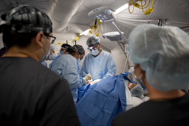 Navy doctors perform surgery