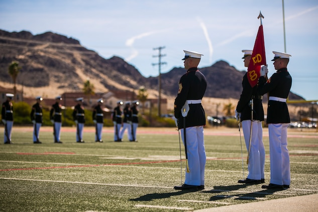 The U.S Marine Corps Silent Drill Platoon, Battle Colors Detachment, Marine Barracks Washington, D.C., performs during the Battle Colors Ceremony at Felix Field aboard the Marine Corps Air Ground Combat Center, Twentynine Palms, Calif., March 14, 2018. The ceremony is held to honor Marine Corps traditions through the Drum Corps, the Silent Drill Platoon and the Battle Colors Detachment.  (U.S. Marine Corps photo by Lance Cpl. Margaret Gale)