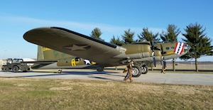 (03/14/2018) -- The B-17F Memphis Belle moves along the tow path toward the WWII Gallery at the National Museum of the United States Air Force on March 14, 2018. Plans call for the aircraft to be placed on permanent public display in the WWII Gallery here at the National Museum of the U.S. Air Force on May 17, 2018. (U.S. Air Force photo by Robert Bardua)