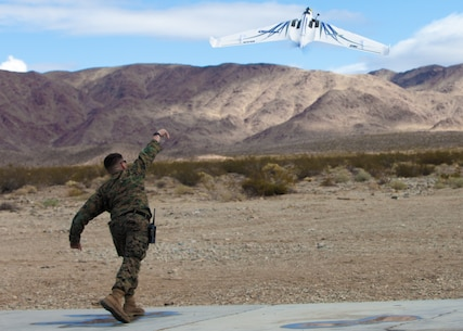 Capt. David Murray, Fabrication Lab OIC, MCAGCC, launches the OPTERRA Unmanned Aerial System aboard the Marine Corps Air Ground Combat Center, Twentynine Palms, Calif., March 15, 2018. The Fabrication Lab is a facility for Marines and authorized civilians to innovate and experiment to overcome the common obstacles the Marine Corps provides. (U.S. Marine Corps photo by Cpl. Devin J. Andrews)