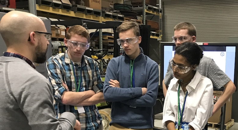 Dr. Eric Payton, Materials Research Engineer, demonstrates the differences between two types of metals to students from local high schools. The students participated in the 2018 Spring Job Shadow Program at Wright Patterson Air Force Base, where they spent the day learning about Mechanical Engineering career fields within the Air Force. (U.S. Air Force Photo/Staff Sgt. Whitney Trimble)