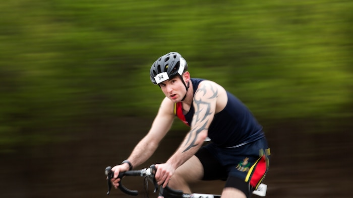 Royal Marine Connor Moore races down Holcomb Boulevard at the 2018 Marine Corps Trials cycling competition at Marine Corps Base Camp Lejeune, N.C., March 18, 2018. The Marine Corps Trials promotes recovery and rehabilitation through adaptive sport participation and develops camaraderie among recovering service members and veterans. It is as an opportunity for RSMs to demonstrate their achievements and serves as the primary venue to select Marine Corps participants for the DoD Warrior Games.