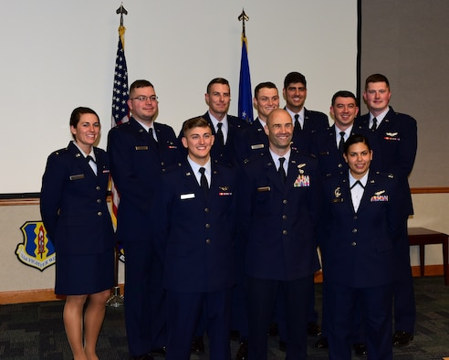 Undergraduate Air Battle Manager training program class 18008 pose for a group photo after their graduation ceremony at Tyndall Air Force Base, Fla., March 16, 2018. Air battle managers' primary responsibilities include providing command and control in the battlespace and ensuring combat aircraft find, identify and destroy their targets. They do this by providing the pilots with a tactical picture, which increases combat capability and situational awareness. Air battle managers also provide early warning for inbound enemy aircraft and direct friendly assets to intercept them. (U.S. Air Force photo by Senior Airman Cody R. Miller/Released)