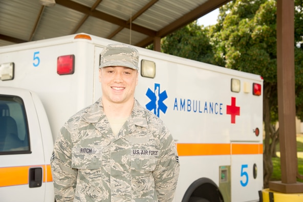 Senior Airman Brandon J. Fitch, 940th AMDS aerospace medical technician, stands in front of an ambulance March 4 at Beale Air Force Base, California.