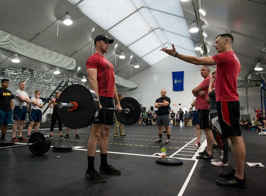 Senior Airman Taylor Keller, 56th Equipment Maintenance Squadron aerospace ground equipment technician, performs a deadlift to demonstrate proper form during the 2018 Reebok CrossFit Games Open 18.4 at Luke Air Force Base, Ariz., March 15, 2018. The open is the first stage of the CrossFit Games season and the largest community CrossFit event of the year. (U.S. Air Force photo by Airman 1st Class Alexander Cook)