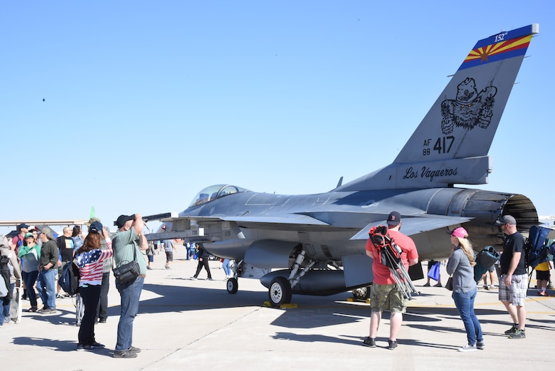 Onlookers gather to observe the F-16 Fighting Falcon from Tucson, Arizona and talk to readily available pilots, to learn more about the lethality and aerodynamic capabilities of the aircraft here, during the Luke Days Air Show, March 17, 2018. The wing has trained pilots from 25 countries that fly the F-16 today while developing strategic partnerships and building strong international relationships based on performance, friendship, and trust. (U.S. Air National Guard photo by 1st Lt. Tinashe Machona)