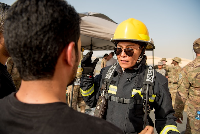Senior Master Sgt. Mireya Calderafavela, force protection superintendent from the 379th Expeditionary Civil Engineer Squadron, prepares to participate in a firefighter challenge exercise at Al Udeid Air Base, Qatar, March 8, 2018. The a exercise, a strenuous course designed to test physical fitness and fire response capabilities, was organized by firefighters from the 379th ECES and Qatar Emiri Air Force. (U.S. Air Force photo by Staff Sgt. Joshua Horton)