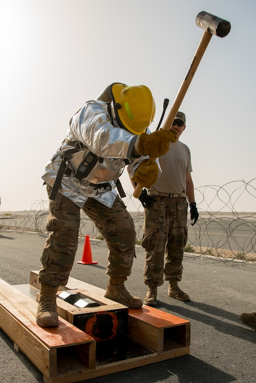 Members of the 379th Air Expeditionary Wing and Qatar Emiri Air Force participate in a firefighter challenge exercise at Al Udeid Air Base, Qatar, March 8, 2018. The a exercise, a strenuous course designed to test physical fitness and fire response capabilities, was organized by firefighters from the 379th ECES and Qatar Emiri Air Force. (U.S. Air Force photo by Staff Sgt. Joshua Horton)