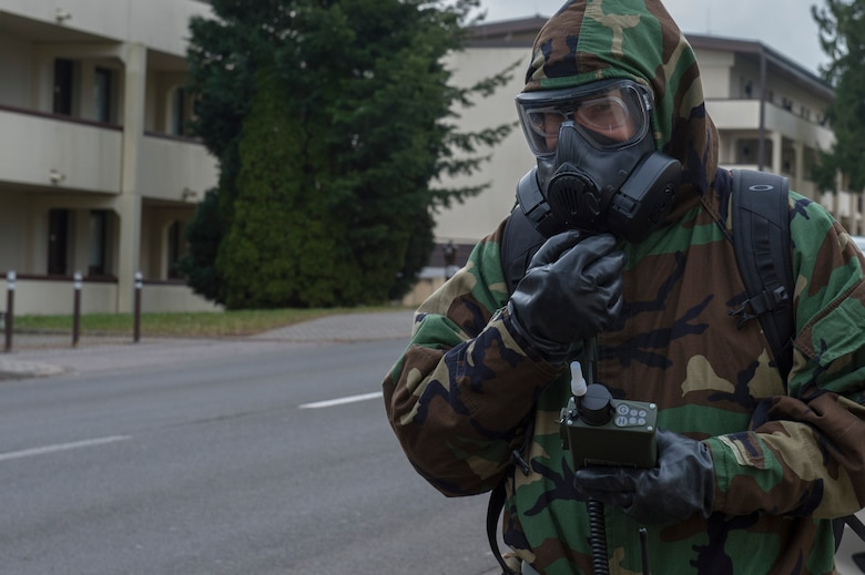 U.S. Air Force Tech. Sgt. Timothy Bennett, 52nd Civil Engineer Squadron post-attack reconnaissance team lead, radios to the chemical, biological, radiological and nuclear defense control center during PAR sweep at Spangdahlem Air Base, Germany, March 15, 2018. CBRN defense protective measures are taken in situations where CBRN warfare hazards may be present. (U.S. Air Force photo by Senior Airman Dawn M. Weber)