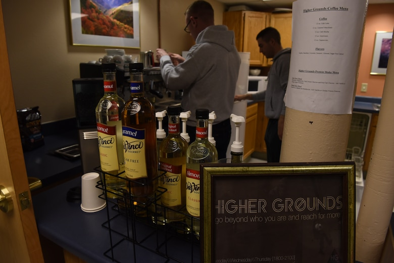 The Airmen volunteers are taught how to use the coffee machine at Higher Grounds and after dinner they take orders for those requesting a drink at F.E. Warren Air Force Base, Wyoming, March 14, 2018. Higher Grounds provides six flavorings that can be added into the coffee and for the non-coffee drinkers there are protein smoothies. (U.S. Air Force photos by Airman 1st Class Abbigayle Wagner)