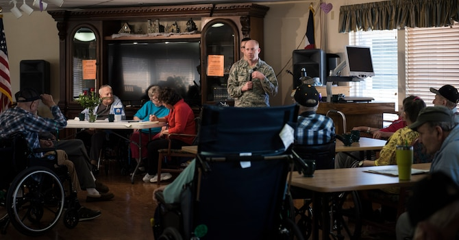 FLORENCE, Colo. – Capt. Kevin Mitchell, 21st Space Wing Judge Advocate litigation chief, speaks to members of the Bruce McCandless Colorado State Veterans Nursing Home in Florence, Colo., March 3, 2018. This visit was made to ensure retirees at the home knew of their eligibility for free legal services as Peterson Air Force Base, Colo. (U.S. Air Force Photo by Airman 1st Class Alexis Christian)