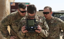 1st Security Forces Assistance Brigade (SFAB) Soldiers from Fort Benning, Ga. learn how to use the Instant Eye technology while their drone is in flight, Mar. 6, 2018. The Instant Eye allows the Soldier to see what the drone camera is capturing as well as control the drones movement and flight path.