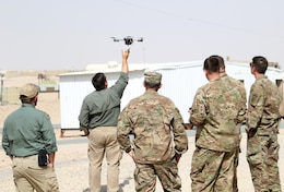 Instructors from ARCENT Readiness Training Center - Kuwait (ARTC-KU) demonstrate how to launch a drone using Instant Eye technology for 1st Security Forces Assistance Brigade (SFAB) Soldiers, Mar. 6, 2018. The 1st SFAB recently deployed from Fort Benning, Ga. and will proceed to their final destination in Afghanistan.
