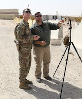 Staff Sgt. Warren Palmer, master trainer and senior intelligence advisor, Delta Company, 5th Battalion, 1st Security Forces Assistance Brigade, left, and Mike Podplesky, ARCENT Readiness Training Center - Kuwait (ARTC-KU) team lead, control the movements of a PD-100 Black Hornet Nano Drone as it flies, Mar. 6, 2018. The Black Hornet weighs 18 grams and has a vertical ceiling of almost two miles.