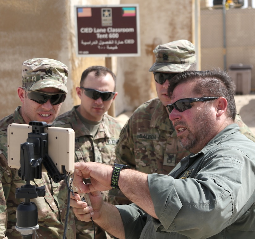 Mike Podplesky from ARCENT Readiness Training Center - Kuwait (ARTC-KU) demonstrates to 1st Security Forces Assistance Brigade (SFAB) Soldiers how to launch a PD-100 Nano Drone, Mar. 6, 2018. The Black Hornet weighs 18 grams and has a vertical ceiling of almost two miles.