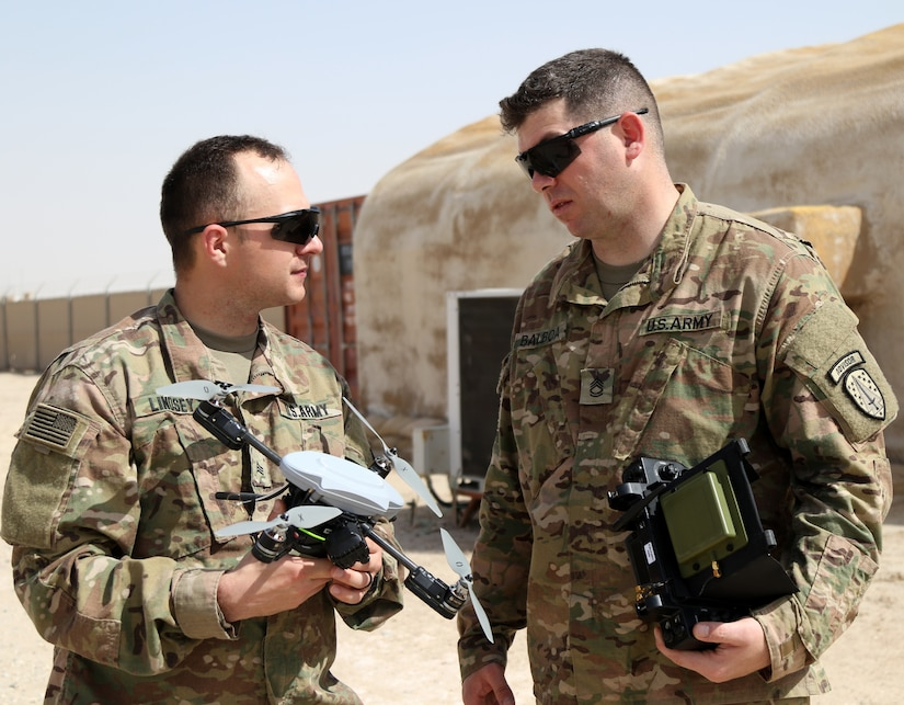 Sgt. Joseph Lindsey, signal systems repair specialist, left, and Sgt. 1st Class Derek Balboa, master trainer and team sergeant, both attached to the Alpha Company, 1st Battalion, 1st Security Forces Assistance Brigade, discuss their drone and its flying capabilities, Mar. 6, 2018. Both Soldiers, stationed out of Fort Benning, Ga., are taking part in Small Unmanned Arial System (SUAS) and Counter Small Unmanned Arial System (CUAS) training before proceeding to their final destination in Afghanistan.