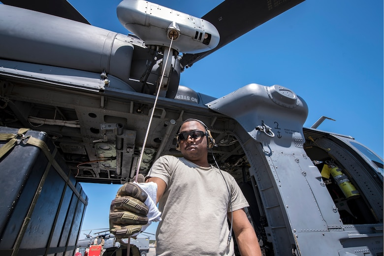 Senior Airman Latrell Solomon, 41st Rescue Squadron (RQS) special missions aviator, wipes the rappel wire of an HH-60G Pave Hawk, March 15, 2018, at Moody Air Force Base, Ga. Airmen from the 41st RQS and 723d Aircraft Maintenance Squadron conducted pre-flight checks to ensure that an HH-60G Pave Hawk was fully prepared for a simulated combat search and rescue mission. (U.S. Air Force photo by Airman Eugene Oliver)