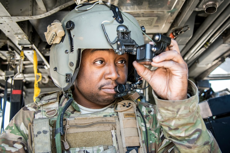 Senior Airman Latrell Solomon, 41st Rescue Squadron (RQS) special missions aviator, inspects his personal helmet camera, March 15, 2018, at Moody Air Force, Ga. Airmen from the 41st RQS and 723d Aircraft Maintenance Squadron conducted pre-flight checks to ensure that an HH-60G Pave Hawk was fully prepared for a simulated combat search and rescue mission. (U.S. Air Force photo by Airman Eugene Oliver)