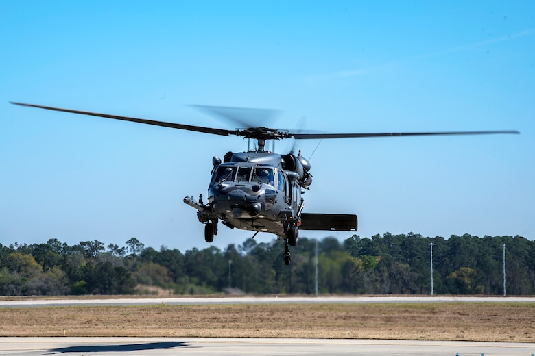 An HH-60G Pave Hawk hovers over the flight line, March 15, 2018, at Moody Air Force Base, Ga. Airmen from the 41st RQS and 723d Aircraft Maintenance Squadron conducted pre-flight checks to ensure that an HH-60G Pave Hawk was fully prepared for a simulated combat search and rescue mission. (U.S. Air Force photo by Airman Eugene Oliver)