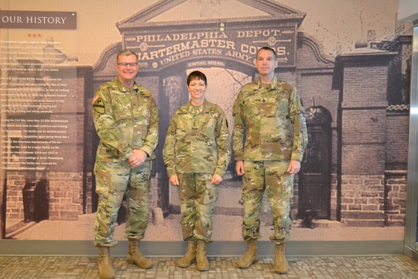 From left, Army Brig. Gen. Mark Simerly, DLA Troop Support commander, Maj. Gen. Barbara Holcomb, U.S. Army Medical Research and Material Command commanding general, and Command Sgt. Maj. David Rogers pose for a picture at DLA Troop Support, March 16, 2018 in Philadelphia.