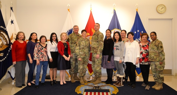 Army Maj. Gen. Barbara Holcomb, U.S. Army Medical Research and Material Command commanding general, left center, and Command Sgt. Maj. David Rogers, right center, pose with Brig. Gen. Mark Simerly, DLA Troop Support commander, and the flag room staff at DLA Troop Support, March 16, 2018, in Philadelphia.