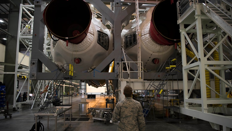 1st. Lieutenant Drew Carrigan, 5th Space Launch Squadron Air Force Responsible Engineer, inspects a set Delta IV heavy boosters during a routine inspection, March 14, at Cape Canaveral Air Force Station, Fla. (U.S. Air Force photo by Airman 1st Class Dalton Williams