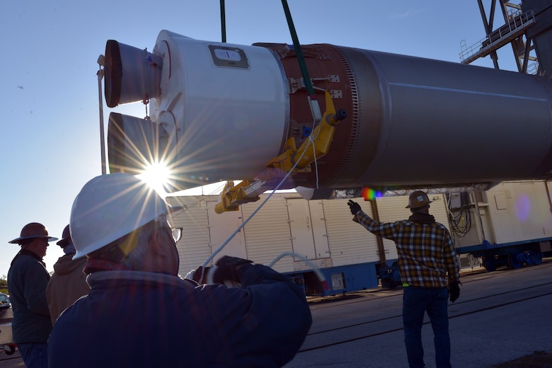 United Launch Alliance employees work to raise and secure an Atlas V booster at the United Launch Alliance Vertical Integration Facility, located on Cape Canaveral Air Force Station, Fla.,  March 13. (U.S. Air Force photo by Airman Zoe Thacker)