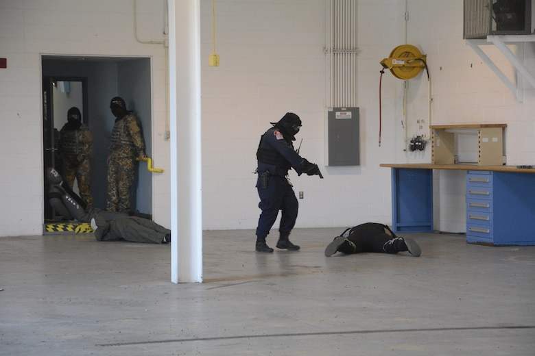 Active shooter tactics familiarization event between the Michigan Air National Guard, military personnel from the Republic of Latvia, and a local Michigan police force was held on March 16, 2018, facilitated by the 110th Attack Wing Security Forces Squadron, Battle Creek Air National Guard Base, Mich. (U.S. Air National Guard photo/Airman 1st Class Tiffany Clark)
