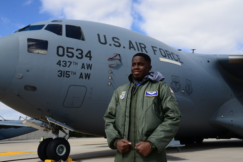 Kareem Bennett, 3rd Airlift Squadron honorary pilot for a day, stands in front of a C-17 Globemaster III March 16, 2018, on the flightline at Dover Air Force Base, Del. Bennett, a patient at Alfred I. duPont Hospital for Children in Wilmington, Del., was invited by the squadron to spend the day with them and learn what the Air Force is all about. (U.S. Air Force photo by Staff Sgt. Aaron J. Jenne)