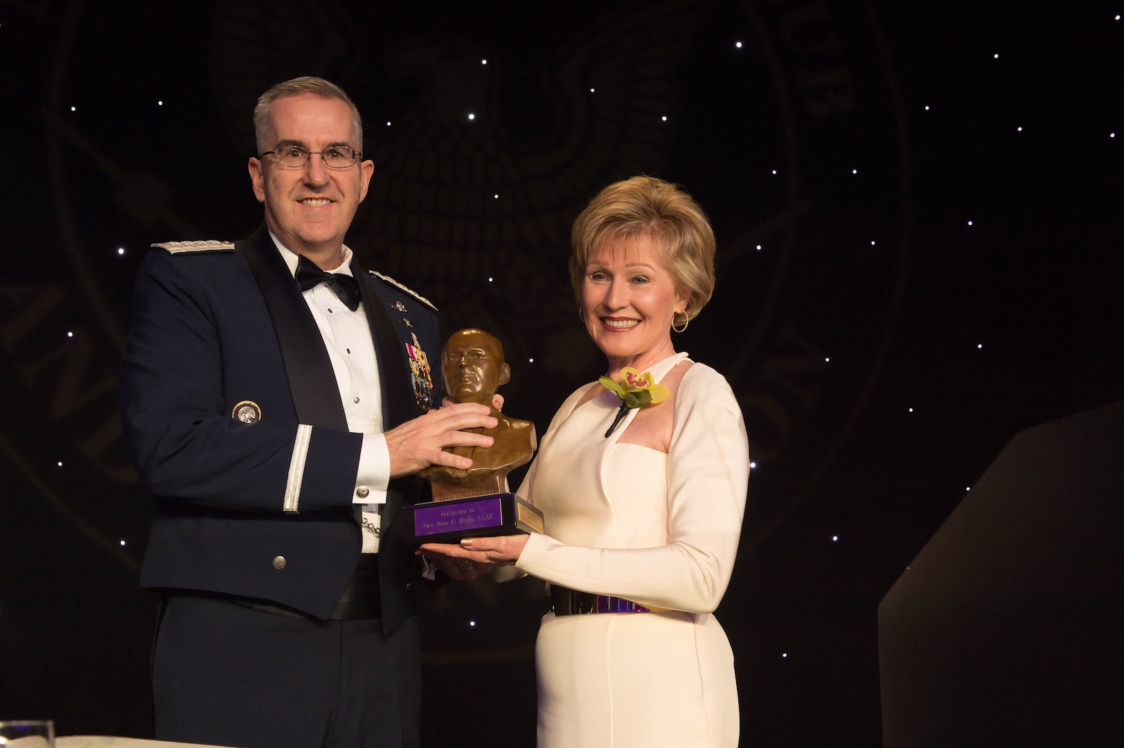 National Space Club & Foundation Board of Director President Sandy Coleman presents U.S. Air Force Gen. John Hyten the Dr. Robert H. Goddard Memorial Trophy at the 61st Annual Robert H. Goddard Memorial Dinner in Washington, D.C., March 16, 2018. Hyten was honored for his distinguished military career and his ongoing efforts dedicated to the National Security Space Enterprise.