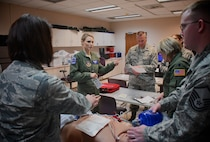 Capt. Jessica Emory, 932nd Aeromedical Evacuation Squadron, and Lt. Col. James Stenger of the 932nd Medical Squadron, give directions and discuss various medical procedures from their unique backgrounds in both military and community work. Members of the 932nd Airlift Wing participated in medical refresher courses March 4, 2018, at Scott Air Force Base, Ill. During this particular class, medical teams from the 932nd Medical Group and 932nd Aeromedical Evacuation Squadron worked in a training area using a simulated (robotic) patient to check vital signs electronically. The training emphasized the breadth of skills necessary to run through checklists, communicate to each person what their role is, and use teamwork to save lives.  (U.S. Air Force photo by Lt. Col. Stan Paregien)