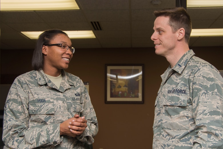 First Lt. Anthony Angell, 375th Air Mobility Wing assistant chaplain, right, visits Airmen from the 375th Force Support Squadron March 5, 2018, at the Military Personnel Section, Scott Air Force Base, Ill. A chaplain's mission is to provide spiritual care and the opportunity for Airmen, their families, and other authorized personnel to exercise their constitutional right to the free exercise of religion. (U.S. Air Force photo by Senior Airman Melissa Estevez)