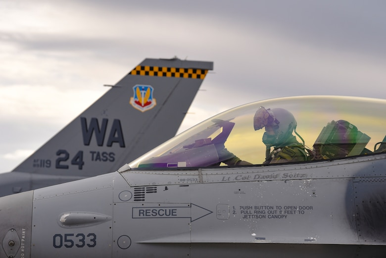 Lt. Col. Daniel McGuire, 57th Wing fighter pilot, sits in the cockpit of an F-16 Fighting Falcon fighter jet assigned to the 24th Tactical Air Support Squadron at Nellis Air Force Base, Nevada, Feb. 27, 2018. The 24th TASS will fly F-16s and focus solely on overcoming air-to-ground adversaries. (U.S. Air Force photo by Airman 1st Class Andrew D. Sarver)