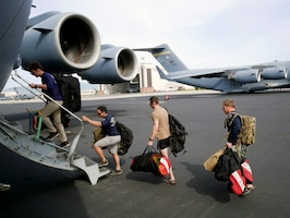 New York Air National Guard Airmen from the 103rd Rescue Squadron, board a C-17 Globmaster III March 4, 2018, at Joint Base Pearl Harbor-Hickam, Hawaii.