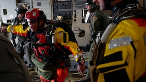 Tech. Sgt. Westley Loignon, 103rd Rescue Squadron pararescueman and jump master, instructs his team to jump off a C-17 Globmaster III March 4, 2017, off the coast of Oahu, Hawaii.