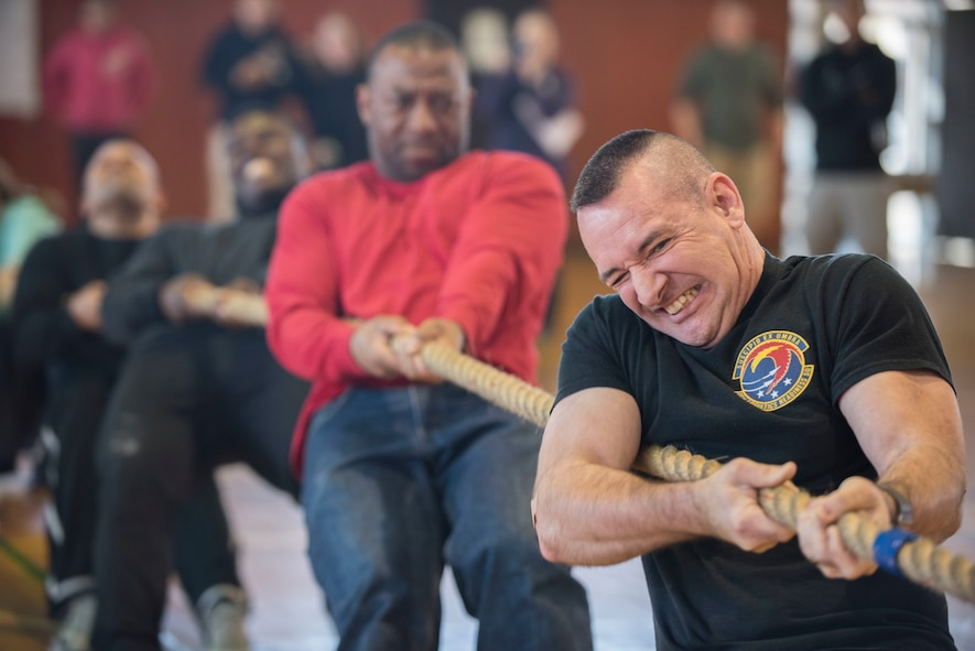 U.S. Air Force Chief Master Sgt. Jay Birtch III, 35th Logistic Readiness Squadron chief enlisted manager, grimaces while pulling a rope during the 16th Annual Northern Air Defense Force Commander's Cup Tug of War Tournament at the Japan Air Self-Defense Force (JASDF) gymnasium at Misawa Air Base, Japan, March 18, 2018. This tug of war event showcased the partnership and friendship between JASDF, U.S. Air Force, and U.S. Navy personnel. There were 19 teams, consisting of three Navy, five Air Force, and 11 JASDF teams who competed for the tug of war championship title. (U.S. Air Force photo by Senior Airman Brittany A. Chase)