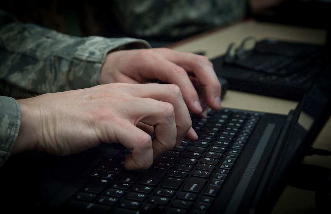 An Airman types on his computer during the Cybersecurity Foundry Course at MacDill Air Force Base, Fla., March 9, 2018. Course instructors taught 100 cyberspace students various cybersecurity functions, processes, procedures and data analysis skills to further their ability to secure the Air Force Network. (U.S. Air Force photo by Senior Airman Mariette Adams)