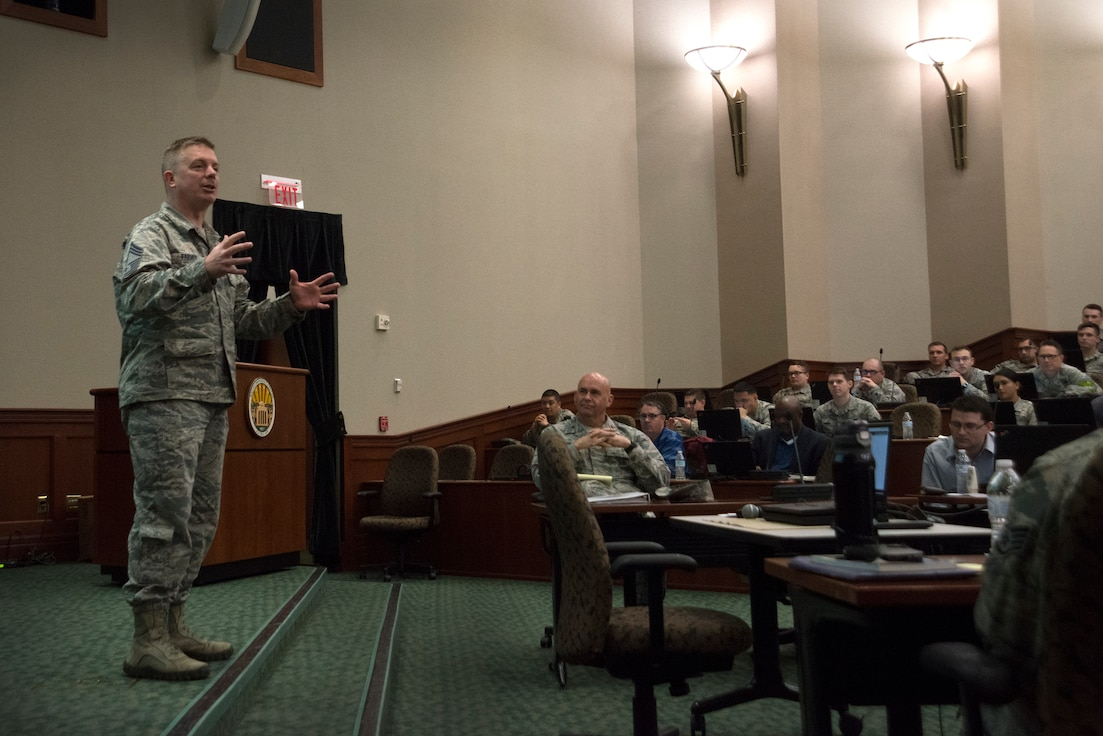Chief Master Sergeant James Farmer, 690th Cyberspace Operations Group superintendent, answers questions during the Cybersecurity Foundry Course at MacDill Air Force Base, Fla., March 14, 2018. Course instructors taught 100 cyberspace students various cybersecurity functions, processes, procedures and data analysis skills to further their ability to secure the Air Force Network. (U.S. Air Force photo by Airman 1st Class Scott Warner)