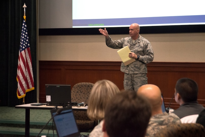 Col. Gregory Davis, 690th Cyberspace Operations Group commander, gives closing remarks at the inaugural Cybersecurity Foundry Course at MacDill Air Force Base, Fla., March 14, 2018. Course instructors taught 100 cyberspace students various cybersecurity functions, processes, procedures and data analysis skills to further their ability to secure the Air Force Network. (U.S. Air Force photo by Airman 1st Class Scott Warner)