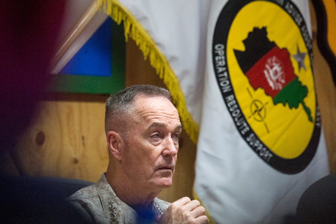 Marine Corps Gen. Joe Dunford, chairman of the Joint Chiefs of Staff, looks off to the right.