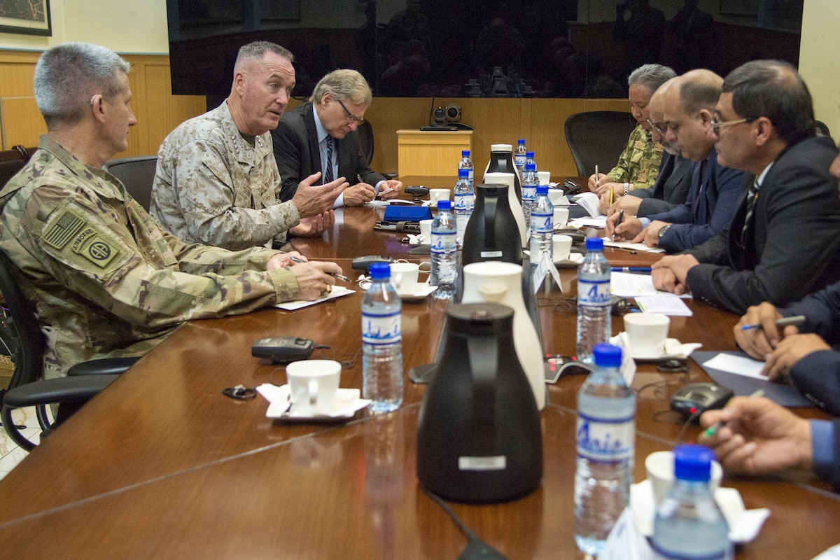 U.S. military leaders meet with Afghan leaders around a table in Kabul, Afghanistan.