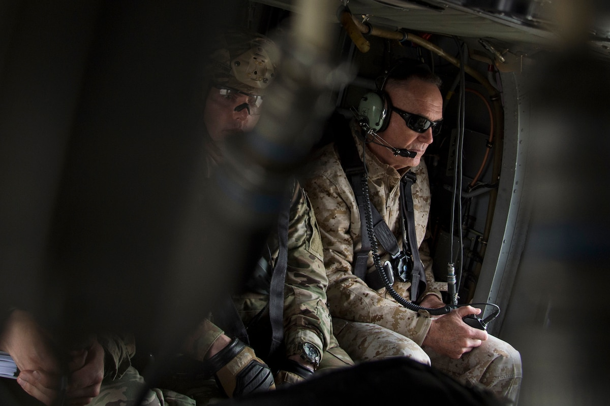 The chairman of the Joint Chiefs of Staff sits in a helicopter