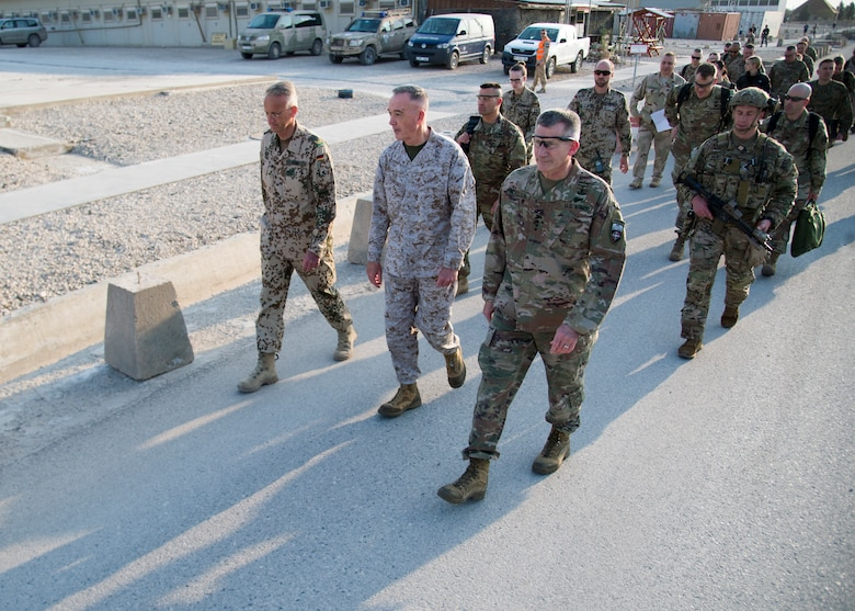 Marine Corps Gen. Joe Dunford, chairman of the Joint Chiefs of Staff, meets Brig. Gen. Wolf-Jürgen Stahl, Train Advise Assist Command - North commander, during a visit to Mazar-i-Sharif, Afghanistan, March 20, 2018. The senior leaders discussed the current security environment in Afghanistan, the progress of the Afghan National Defense and Security Forces, and the re-posturing of U.S. forces as part of the new South Asia strategy.