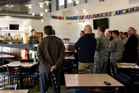 Col. Ethan Griffin, 436th Airlift Wing commander, greets Team Dover's honorary commanders before their tour March 14, 2018,  at Dover Air Force Base, Del. Honorary commanders are selected annually and are invited to continue their involvement with Dover AFB as an honorary commander alumni after their year is complete. (U.S. Air Force photo by Airman 1st Class Zoe M. Wockenfuss)